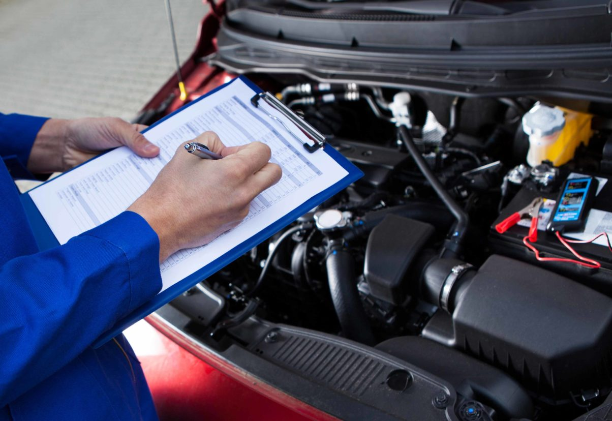 car service technician performing scheduled maintenance in austin texas near cedar park and round rock